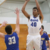 JAY YOUNG   THE GOSHEN NEWS<br /> Bethany Christian sophomore KeShawn Smith (40) pulls up for a jumper in front of Triton junior Dylan Hensley (33) during their game Tuesday night at Bethany.