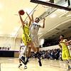 JAY YOUNG | THE GOSHEN NEWS<br /> Fairfield junior Luke Stephens takes the ball in against Elkhart Christian Academy senior Jonah Jara Wallick (33) during their game Tuesday night in Elkhart.