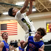 JAY YOUNG | THE GOSHEN NEWS<br /> Fairfield sophomore Cordell Hofer pulls down a lob pass over West Noble senior Walker Donley (15) during their 3A sectional championship game on Saturday night.