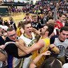 JAY YOUNG | THE GOSHEN NEWS<br /> Fairfield senior Zach Munn celebrates with students following their 3A sectional championship victory over West Noble on Saturday night in Syracuse.