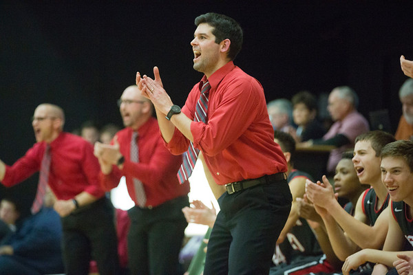 JAY YOUNG | THE GOSHEN NEWS<br /> Goshen High coach Michael Wohlford applauds his team's effort during the Redhawks' game against Elkhart Christian Academy Tuesday night in Elkhart.