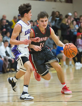 JAY YOUNG | THE GOSHEN NEWS<br /> Goshen High junior Will Line (11) looks for a path around Elkhart Christian Academy defender Jakob Maxwell  during their game Tuesday night in Elkhart.