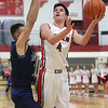 JAY YOUNG | THE GOSHEN NEWS<br /> Goshen High senior Michael Pinarski (4) floats past Elkhart Central junior Jacob Kaiser as he gets a shot off during their game in the 2016 Holiday Basketball Tournament hosted by Goshen High.