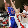 JAY YOUNG | THE GOSHEN NEWS<br /> West Noble sophomore Trevor Franklin (23) hangs in the air to get a shot off over Goshen High defenders Michael Pinarski and Porter Revoir (32) during their game Tuesday night at Goshen High School.