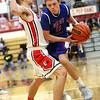 JAY YOUNG | THE GOSHEN NEWS<br /> West Noble sophomore Takota Weigold (11) pushes into Goshen High senior Eliot Nafziger to create space during their game Tuesday night at Goshen High School.