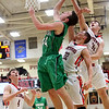 JAY YOUNG | THE GOSHEN NEWS<br /> NorthWood senior Trey Bilinski (31) gets the block as he and teammate Caleb Lung (22) defend a shot by Concord junior Matt Auger (44) during their game Thursday night in Nappanee.