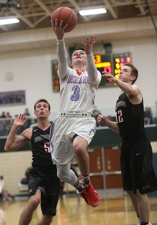 JAY YOUNG | THE GOSHEN NEWS<br /> Lakeland senior Britain Isaacs (3) gets loose for an easy two points after slipping past NorthWood defenders Vincent Miranda (5) and Caleb Glick (12) during the quarterfinals of the 3A sectional Tuesday night at Wawasee High School in Syracuse.