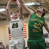 JAY YOUNG | THE GOSHEN NEWS<br /> Wawasee junior Jairus Boyer (20) draws a foul on Tippecanoe Valley senior Jarod Duzenberry (40) during the quarterfinals of the 3A sectional Tuesday night at Wawasee High School in Syracuse.