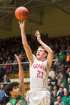 SAM HOUSEHOLDER | THE GOSHEN NEWS<br /> Goshen senior Deric Haynes shoots over Concord senior Ramon Johnson during the 4A Sectional game Saturday at North Side Gymnasium in Elkhart.