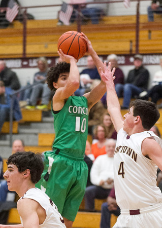 SAM HOUSEHOLDER | THE GOSHEN NEWS<br /> Concord senior Ramon Johnson shoots over Jimtown sophomore Trevor Hobbs during the game Friday.