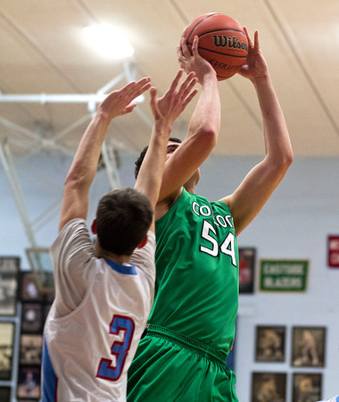 SAM HOUSEHOLDER | THE GOSHEN NEWS<br /> Concord junior Filip Serwatka shoots over Lakeland's Daemyn Preistley