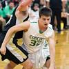 SAM HOUSEHOLDER | THE GOSHEN NEWS<br /> Concord senior Brett Austin dribbles past a Penn player during the game Friday.