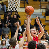 SAM HOUSEHOLDER | THE GOSHEN NEWS<br /> Goshen junior Austin Woolett shoots over Elkhart Memorial defenders during the game Friday.