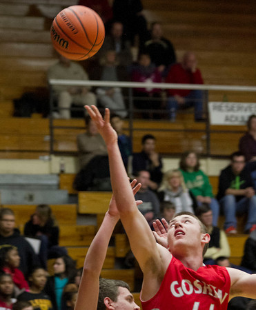 SAM HOUSEHOLDER | THE GOSHEN NEWS<br /> Goshen junior Austin Woolett shoots during the game against Elkhart Memorial Friday at Northside Gymnasium in Elkhart.