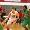 SAM HOUSEHOLDER | THE GOSHEN NEWS<br /> Goshen junior James Paetkau dribbles past Concord sophomore Brandon Emerick Friday during the game.