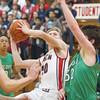 SAM HOUSEHOLDER | THE GOSHEN NEWS<br /> Goshen junior Colton Potter puts up a shot over Concord senior Danny McMahon during the game Friday.
