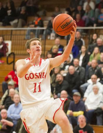 SAM HOUSEHOLDER | THE GOSHEN NEWS<br /> Goshen junior Jack Gingerich goes up for a lay up against NorthWood Friday during the game.