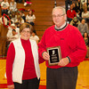 SAM HOUSEHOLDER | THE GOSHEN NEWS<br /> Retired Goshen High School principal Jim Kirkton, right and his wife Vicky stand with the plaque they were presented at halftime of the Goshen boys basketball game Friday.