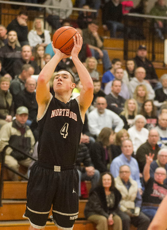 SAM HOUSEHOLDER | THE GOSHEN NEWS<br /> NorthWood senior Zach Zurcher shoots the ball against Goshen Friday.