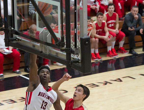 SAM HOUSEHOLDER | THE GOSHEN NEWS<br /> NorthWood junior Dakiyron Fox puts in a basket over Westview junior Kade Miller during the game Thursday.