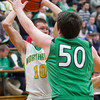 SAM HOUSEHOLDER | THE GOSHEN NEWS<br /> Northridge sophomore Collin Utley looks for an open teammate over Concord junior Danny McMahon Thursday at Northridge High School.