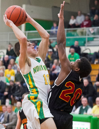 SAM HOUSEHOLDER | THE GOSHEN NEWS<br /> Northridge junior Collin Utley goes up for a shot against Elkhart Central junior Darrius Baker Wednesday during the game.