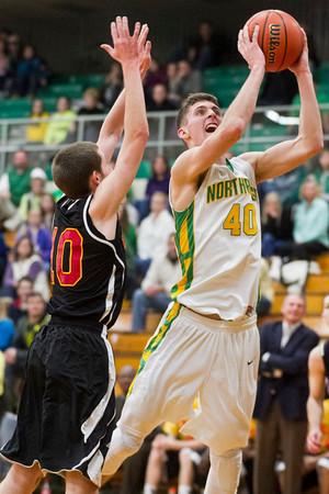 SAM HOUSEHOLDER   THE GOSHEN NEWS<br /> Northridge senior Nate Ritchie shoots over Elkhart Memorial junior Cameron Maxwell during the game Wednesday.