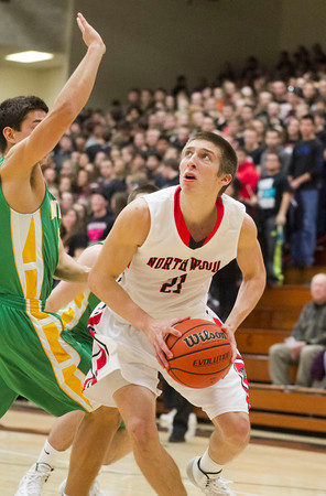 SAM HOUSEHOLDER | THE GOSHEN NEWS<br /> NorthWood senior Jonathan Wilkinson drives past Northridge sophomore Kurtis Hochstetler Friday during the game.