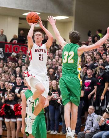 SAM HOUSEHOLDER | THE GOSHEN NEWS<br /> NorthWood senior Jonathan Wilkinson shoots the ball overNorthridge junior Brock Downey during the game Friday at NorthWood High School.