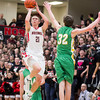 SAM HOUSEHOLDER | THE GOSHEN NEWS<br /> NorthWood senior Jonathan Wilkinson shoots the ball overNorthridge junior Brock Downey during the game Friday at NorthWood High School.