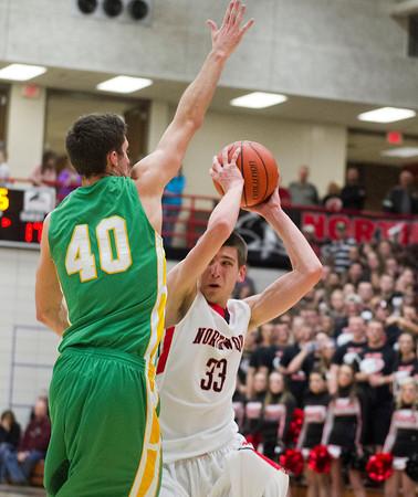 SAM HOUSEHOLDER | THE GOSHEN NEWS<br /> NorthWood senior Will Stueve looks to get past Northridge senior Nate Ritchie Friday during the game.