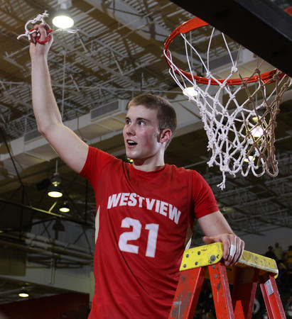 CHAD WEAVER | THE GOSHEN NEWS<br /> Westview senior Jamar Weaver holds up his piece of the net following Saturday's 2A semi-state at Huntington North High School. Westview won 65-58.