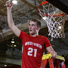 CHAD WEAVER   THE GOSHEN NEWS<br /> Westview senior Jamar Weaver holds up his piece of the net following Saturday's 2A semi-state at Huntington North High School. Westview won 65-58.