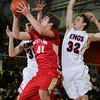 CHAD WEAVER   THE GOSHEN NEWS<br /> Westview senior Chandler Aspy takes a shot while being guarded by Evan Ohman and Drew McRae of Lewis Cass during the first half of Saturday's 2A semi-state at Huntington North High School. Westview won 65-58.