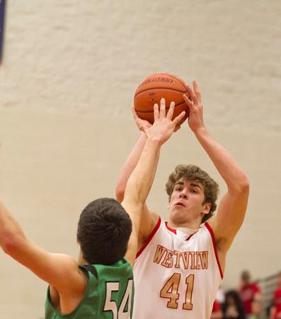 SAM HOUSEHOLDER | THE GOSHEN NEWS<br /> Westview junior Chandler Aspy shoots over Concord junior Filip Serwatka Friday during the game.