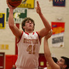 SAM HOUSEHOLDER | THE GOSHEN NEWS<br /> Westview junior Chandler Aspy shoots a basket over Concord junior Brett Austin Friday during the game.