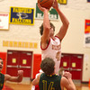 SAM HOUSEHOLDER | THE GOSHEN NEWS<br /> Westview senior Chandler Aspy shoots over Wawasee junior Gage Reinhard during the game Tuesday at Westview High School.