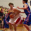 SAM HOUSEHOLDER | THE GOSHEN NEWS<br /> Westview junior Chandler Aspy looks to shoot over West Noble senior Drew Schermerhorn, back, and junior Waylon Richardson, right during the game Friday.