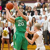 SAM HOUSEHOLDER | THE GOSHEN NEWS<br /> Concord senior Adam Glanders goes up to shoot over Jimtown sophomore Adam DeShone during the game Friday at Jimtown High School.