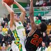SAM HOUSEHOLDER | THE GOSHEN NEWS<br /> Northridge junior Collin Utley goes up for a shot against Elkhart Central junior Darrius Baker Wednesday during the game.