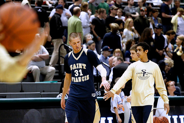 Record-Eagle/Jan-Michael Stump<br /> Traverse City St. Francis' Sean Sheldon (31) and Devin Sheey (11) warm up for Saturday's Class C state finals game against Flint Beecher in East Lansing.