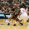 Record-Eagle/Jan-Michael Stump<br />  Flint Beecher's Eric Cooper(12) tries to strip the ball from Traverse City St. Francis' Devin Sheehy (11) in the first half of Saturday's Class C state finals in East Lansing.