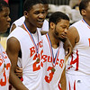 Record-Eagle/Jan-Michael Stump<br /> Flint Beecher's Emmanuel Phifer (25) and Montana Gooch (3) walk off the court after defeating Traverse City St. Francis in Saturday's Class C state finals in East Lansing.