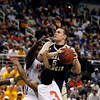 Record-Eagle/Jan-Michael Stump<br /> Traverse City St. Francis Nick Clear (5) drives between Flint Beecher's Jequarius French (33) and Montana Gooch (3) in the first half of Saturday's Class C state finals in East Lansing.
