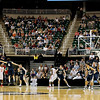 Record-Eagle/Jan-Michael Stump<br /> Flint Beecher's Antuan Burks (20) shoots over Traverse City St. Francis' Ian Spencer (4) in the first half of Saturday's Class C state finals in East Lansing.