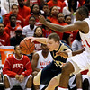 Record-Eagle/Jan-Michael Stump<br /> Traverse City St. Francis' Byron Bulough (21) tries to drive past Flint Beecher's Eric Cooper (12)  in the first half of Saturday's Class C state finals in East Lansing.