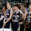 Record-Eagle/Jan-Michael Stump<br /> Traverse City St. Francis players watch Flint Beecher celebrate their74-60 win in Saturday's Class C state finals in East Lansing.