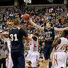 Record-Eagle/Jan-Michael Stump<br /> Traverse City St. Francis' Michael Jenkins (32) grabs a rebound from Flint Beecher's Eric Cooper (12) and Emmanuel Phifer (25) in the second half of Saturday's Class C state finals in East Lansing.