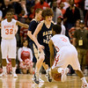 Record-Eagle/Jan-Michael Stump<br /> Traverse City St. Francis' Riley Corcoran (10) defends Flint Beecher's Montana Gooch (3) in the second half of Saturday's Class C state finals in East Lansing.