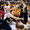 Record-Eagle/Jan-Michael Stump<br /> Traverse City St. Francis' Nick Clear (5) and Kody Kleinrichert (3) fight for the ball with Flint Beecher's Jequarius French (33) in the first half of Saturday's Class C state finals in East Lansing.